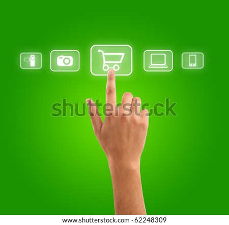 hand choosing shopping cart symbol from media icons on green