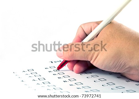 Hand choosing the test list on the examination