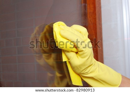 Hand cleaning window. - stock photo
