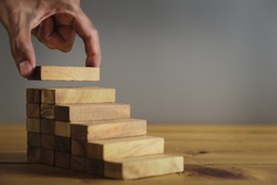 Hand Closer up hands of businessmen,stacking wooden blocks into steps,Concept of business growth success - image