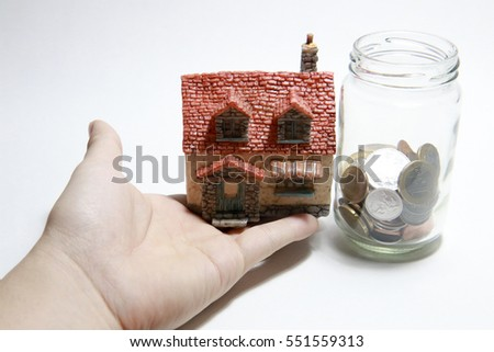 Hand, Coin and house #551559313