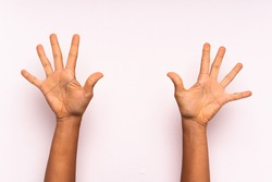hand counting ten over isolated colorful background