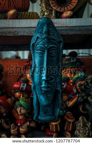 hand craft men or women face statue, statue with close up of face, blue colored statue