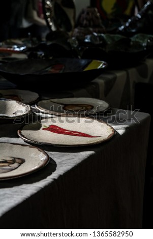 Hand crafted and painted plates on a table. Vintage market. Selling crafts on a spring festival.