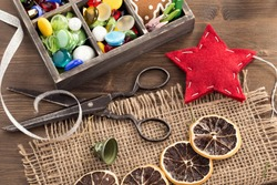 Hand crafted holiday ornaments and vintage scissors top view.