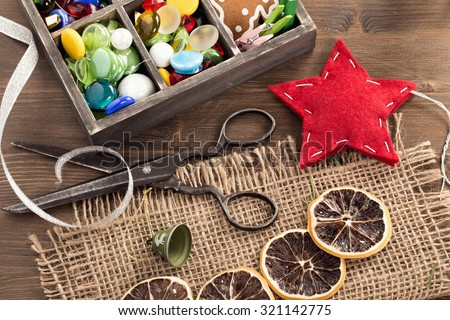Shutterstock Hand crafted holiday ornaments and vintage scissors top view