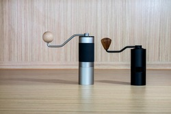 Hand crank coffee grinder on wooden background.Handmade coffee drip concept.