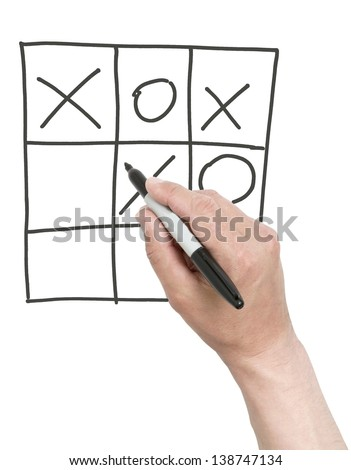 Hand drawing a cross in tick-tack-toe game. Isolated on white.