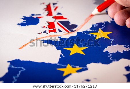 Hand drawing a red line between the UK and the rest of the European Union. Concept of Brexit. The UK is thus on course to leave the EU