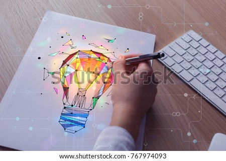 Hand drawing abstract polygonal lamp on paper sheet placed on wooden desk with keyboard. Idea and art concept. Double exposure