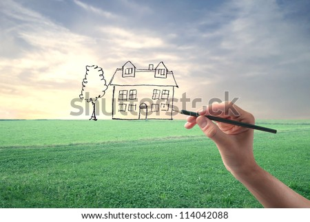 Hand drawing an house on a landscape