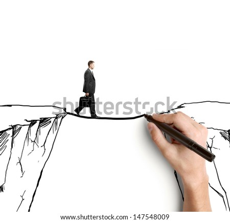 hand drawing businessman on rock