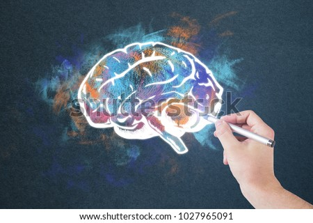 Hand drawing colorful brain sketch on concrete wall background. Brainstorming and idea concept - Shutterstock ID 1027965091
