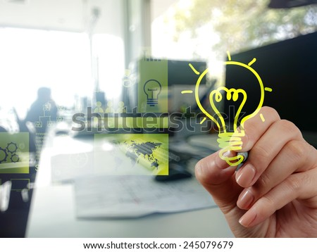 hand drawing creative business strategy with light bulb as concept #245079679