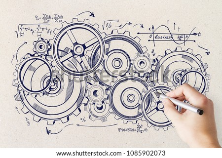 Hand drawing creative cogwheel sketch on concrete wall background. Device and system concept
