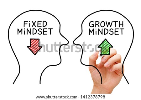 Hand drawing Fixed Mindset vs Growth Mindset success concept with black marker on transparent wipe board. #1412378798
