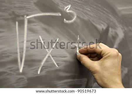 Hand drawing on school desk mathematics formula symbols
