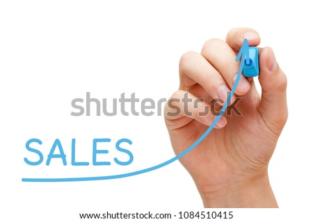 Hand drawing sales growth graph with blue marker on transparent wipe board. #1084510415