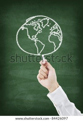 Hand drawing world on chalkboard