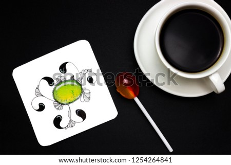 Hand drawn abstract watercolor jewel stone. Time for your hobby. An overhead photo of abstract hand drawn doodle patterns made of black liner pen and candy. Colorful lesson of doodles, cup of coffee #1254264841
