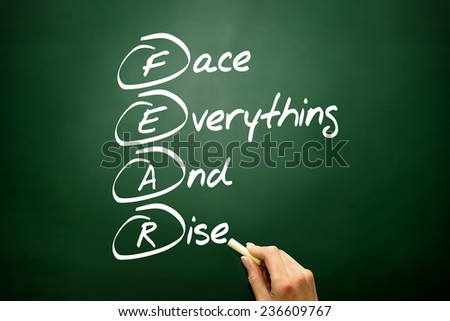 Hand drawn Face Everything And Rise (FEAR) acronym, business concept on blackboard