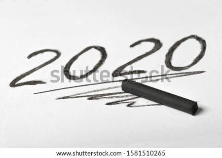 Hand drawn number 2020 and artist's black charcoal. New Year concept. #1581510265