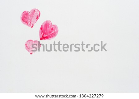 hand drawn pink Valentines Day hearts on the corner of a whiteboard with copyspace #1304227279