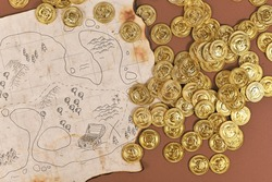 Hand drawn pirate treasure map with toy gold coins for children