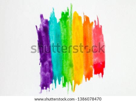 Hand drawn rainbow watercolor paint strokes isolated on white background. Red, orange, yellow, green, blue, purple textured bands. Gay pride flag conceptual #1386078470