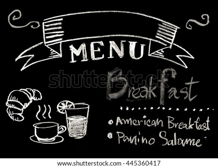 Hand drawn word breakfast menu on chalkboard background with copyspace and black and white style #445360417