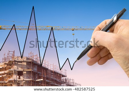 Hand draws a graph with a background of a construction site - concept image #482587525