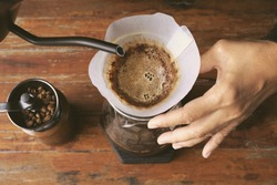 Hand drip coffee, Barista making drip coffee. Top view