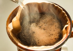 Hand drip coffee , Barista pouring water on coffee ground with filte