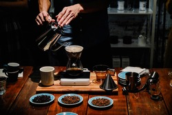 Hand drip coffee , Barista pouring water over the coffee powder