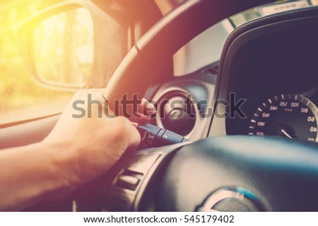 hand driving car and turning...