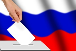 hand drops the ballot election against the background of the Russia flag, concept of state elections, referendum