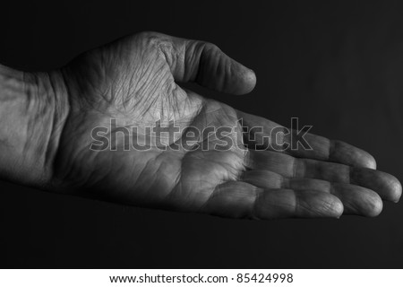 Hand extended to offer or receive something
