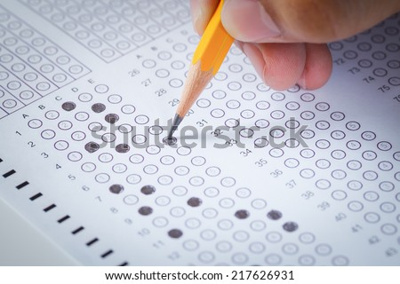 hand fill in Exam carbon paper computer sheet and pencil