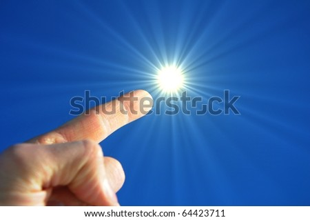 hand finger sky and sun showing freedom concept