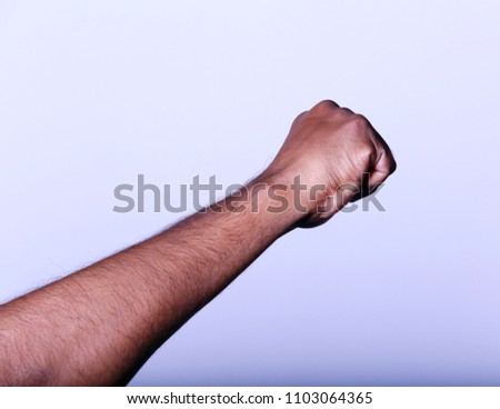 Hand fist staight - Shutterstock ID 1103064365