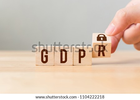 Hand flip wood cube block with word GDPR. Concept legal EU protect information general data protection regulation and sign key icon #1104222218