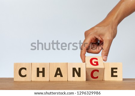 Hand flip wooden cube with the word CHANGE to CHANCE on white background. Concept of personal development #1296329986