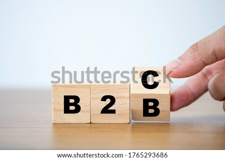 Hand flipping wooden cubes block for change wording B2B to B2C. supply change between Business supplier and customer relations concept. Stockfoto ©