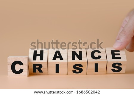 Hand flipping wooden cubes for change wording' Crisis '  to ' Chance'.  Mindset is important for human development. Stock fotó ©