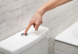 Hand flushing toilet bowl with button
