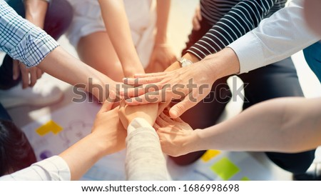 Photo of  Hand for work together concept, Hand stack for business and service, Volunteer or teamwork togetherness, Concept connection of community and charity. Group of happy people or team participation.