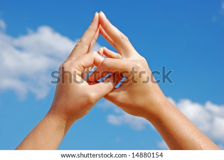 Hand gesture - Mudra - with sky on the background