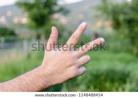 Hand gestures, blured background #1148488454