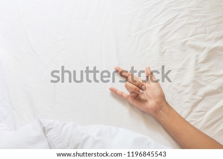 """Hand gestures """"I LOVE YOU"""" on the bedroom. #1196845543"""