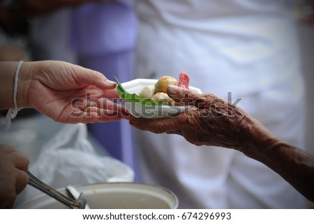 hand give food to hands of a beggar